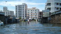 A flooded street in Dhaka, Bangladesh. - Photo: Flickr/Dougsyme