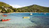 Boats in vibrant colors are seen anchored on Friendship Bay in St. Vincent and Grenadines. - Photo: Shutterstock