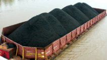 Coal is transported in a barge across a river in Indonesia. - Photo: Shutterstock
