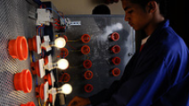 Students working on an assembly of light bulbs at a science fair in Morocco. - Photo: Flickr/World Bank