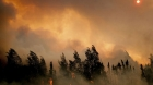 The setting sun is partially obscured by smoke from an out of control 2015 wildfire on the Parks Highway near Willow, Alaska. (Reuters/Mat-Su Borough/Stefan Hinman)